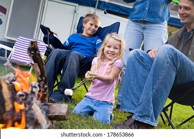 Camping: Little Girl Excited To Cook Marshmallows Over FIre