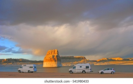 Camping - Lone Rock Beach  - Lake Powell, Arizona - Several RVs camping on the beach near Lone Rock ( a large sandstone monolith)