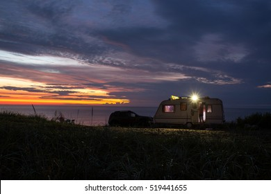 camping, mobile home on the beach, green grass, twilight