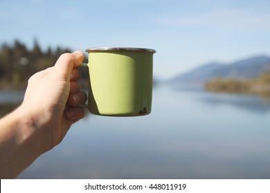 Camping mug at a lake scene.