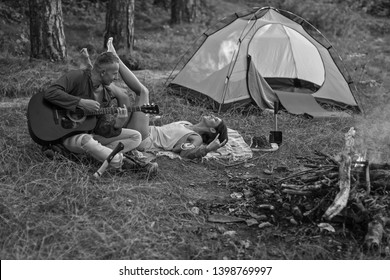 Camping music. Man and woman nature. Forest. Sexy couple. Shadow. Travel. Couple in love. Fire.