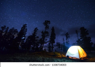 Camping at night under the stars in a tent. Montana wilderness.