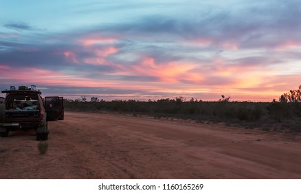 Camping with off road 4wd van in sunset, Outback Australia