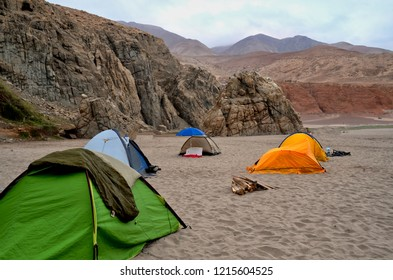 camping on the beach, several tents