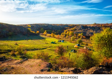 Camping on the hills near the river in the autumn