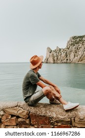 Camping outdoors and Mountains. Young man enjoying the view. Blue sea or Atlantic Ocean in Europe. Film Vintage Modern colors. adventure at the weekend. Background for the inscription