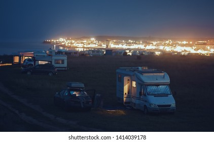 Camping site near the sea with camper vans, travelers expedition hipster holiday campervan journey nomad lifestyle holiday tourism caravan car motorhome outdoor trip, van life tourism travel vacation
