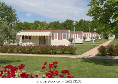 camping site with rows of identical mobil homes