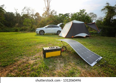 Camping solar panels installed elements equipment with power box and lamp for facilitate camping.