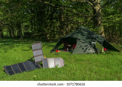camping spot- big tent and three portable solar panels for recharging batteries