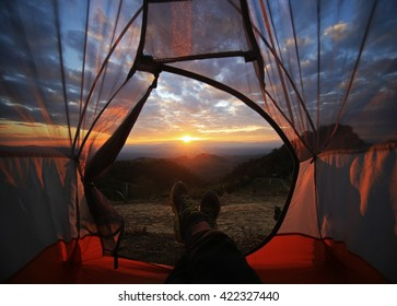A camping tent glows under sunset to a night sky  Outdoor Camping adventure