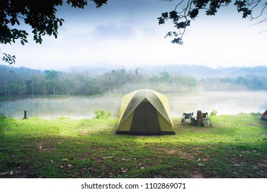 Camping tent with lake background.