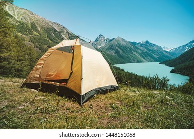 Camping tent with lake background. Beautiful mountain landscape in the Altai mountains. Lake kucherlinskoe. Siberia. Russia.