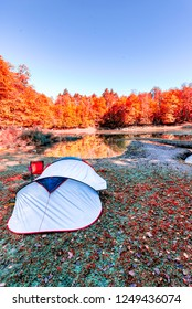 Camping tent in Nature background with morning scenic view at lake and forest pine tree in Yedigoller Nature Park, in Bolu,Turkey.
