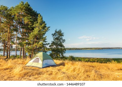 The Camping Tent near the forest lake in Karelia