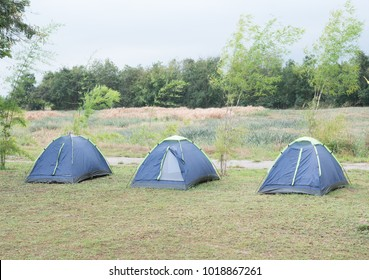 Camping tent on green grass