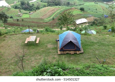 Camping tent on green grass field at Mon Cham with mountain view, Chiang Mai Thailand