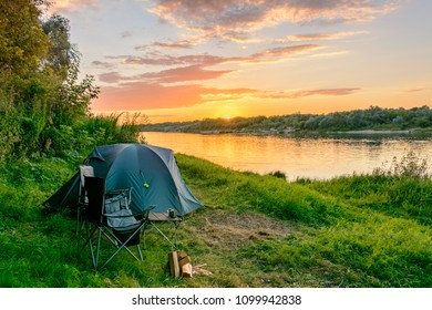 Camping tent and tourist equipment near the river