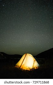 Camping tent under night stars