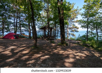 Camping and tent under the oak trees near the sea with beautiful sunlight