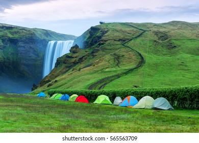 Camping tents near the famous Skogafoss waterfall on Skoga river. Iceland, Europe