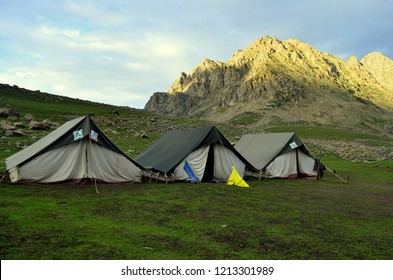 Camping tents near the lakes at the Kashmir Great Lakes trek, which starts from Sonamarg to Naranag Village in Kashmir. This is an alpine himalayan high-altitude trek in Kashmir Valley.