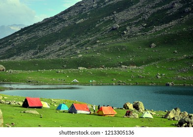 Camping tents at the Nundkol lake which is near the Gangabal lake, at the base of Mount Harmukh. This is the last lake on the Kashmir Great Lake trek which is an alpine high altitude trek in Kashmir.