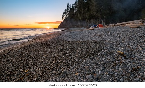 Camping with tents on a rocky beach along the west coast of Vancouver Island on the west coast trail.