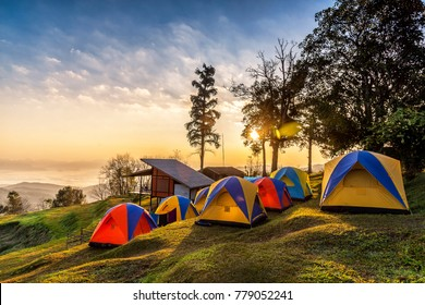 Camping tents on the top of mountain during sunrise at San pa kia to see Doi Luang Chiangdao, Chiang Mai, Thailand.