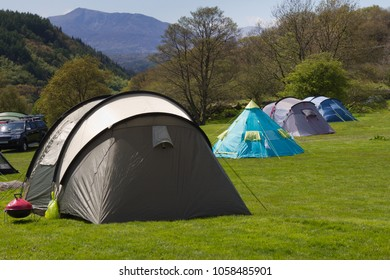 Camping tents with scenic views in rural Wales.