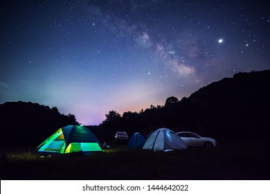 Camping in tents under the stars in summer