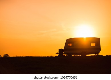 Camping trailer in the setting sun