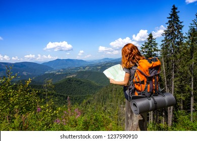 camping trip. girl hiker with a map at the Carpathians mountains. gorgany, Ukraine.