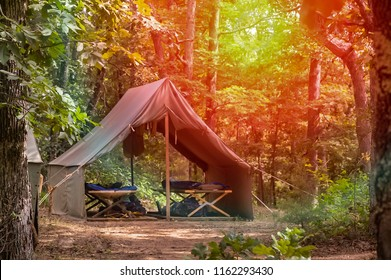 Camping two person tent with cots, summer, sunrise