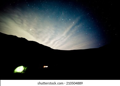 Camping under stars in mountains