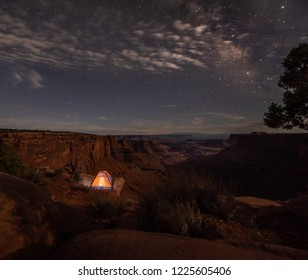 Camping under the stars Small tent on the edge of the canyon Milky Way East Fork Shafer Canyon near Dead Horse Point State Park Canyonlands Utah USA