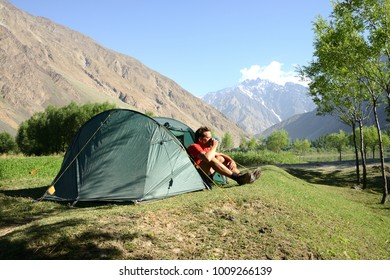 Camping in the Wakhan valley with Afghanistan in the background, Pamir Mountain Range, Tajikistan