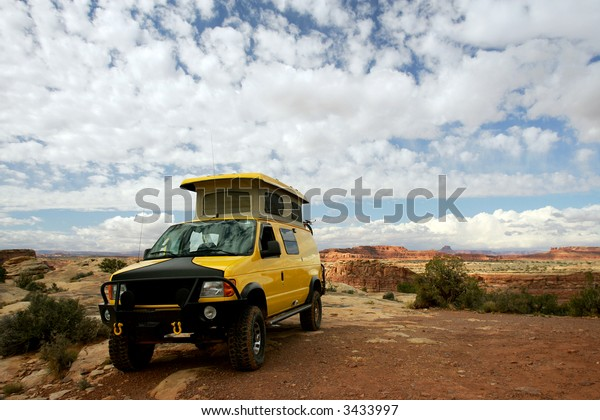 Camping with Yellow RV Van in Valley of Gods, Utah