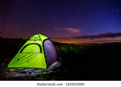 Campjng during night on famous Trolltunga, Norway