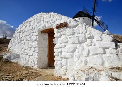 Campo de Criptana, Spain - November 1 2018: Entrance to the Silo Cave next to the mills of Campo de Criptana.