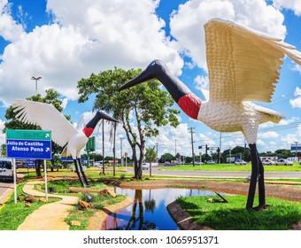 Campo Grande, Brazil - April 10, 2018: Decorative sculptures of two Tuiuiu birds on a puddle of water localized in front of the city's airport (Aeroporto Internacional de Campo Grande).