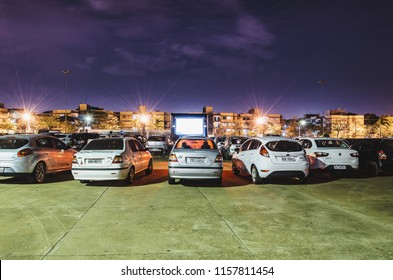 Campo Grande, Brazil - August 16, 2018: Parked cars at Praca do Papa square to watch movies inside the car. Cine Autorama event, drive-in, open air cinema, open to public.