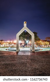 Campo Grande, Brazil - August 21, 2018: Inside of Horto Florestal at night (Parque Florestal Antonio de Albuquerque). Decorative arc, water around and some benchs on the rest area of the park.