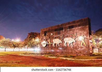 Campo Grande, Brazil - August 21, 2018: Monument Carro de Boi in front of Horto Florestal at night (Parque Florestal Antonio de Albuquerque). Historic spot of the city of Campo Grande MS, Brazil.