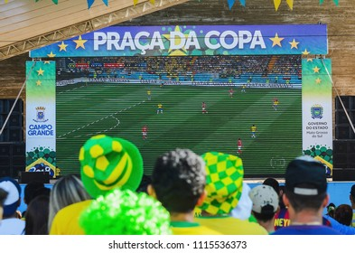 Campo Grande, Brazil - June 17, 2018: Brazilians at a free entrance event organized by the prefecture to watch the world cup on a downtown square of the city. (Brazil vs Switzerland match)