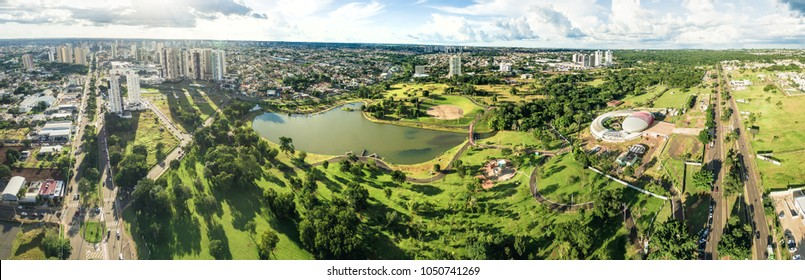 Campo Grande, Brazil - March 16, 2018: Aerial view from the lake of Parque Das Nacoes Indigenas, the biggest park and the Aquario do Pantanal on the Afonso Pena avenue. 180 degrees photography.