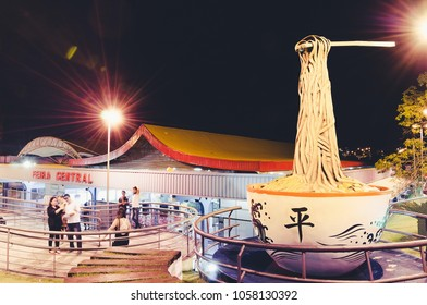 Campo Grande, Brazil - March 29, 2018: Front of the Feira Central De Campo Grande fair with a sculpture of a huge Soba. Soba is a lamen (noodle), part of the local culture. (Festa do Peixe day).