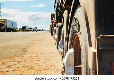 Campo Grande, Brazil - May 24, 2018: Stopped trucks on the highways for protest the diesel price increase. Cities with the truck stoppage are running out of gas at the stations and without supplies.