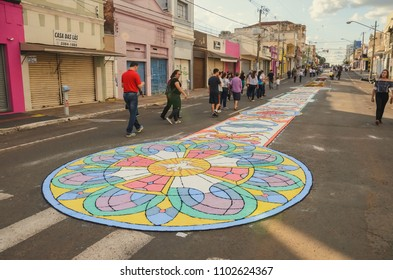 Campo Grande, Brazil - May 31, 2018: Holiday event of Corpus Christi at the 14 de Julho street. People handcrafted a carpet, made of sawdust, with Christian art and messages on the street floor.
