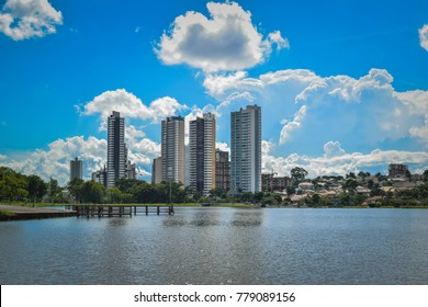 Campo Grande buildings seen from the Parque das Nações Indigenous people with blue sky and clouds
